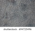 Small photo of Blue gray carpet like towel pattern with inconsistent color