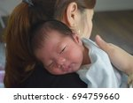 Small photo of Baby,After breastfeeding,Burp,Belch,Mother,14 days after birth
