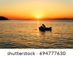 Fisherman In His Boat During...