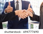 hands of business agreement on... | Shutterstock . vector #694777690