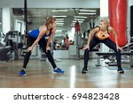 two young athletic women train... | Shutterstock . vector #694823428