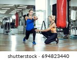 young athletic woman doing... | Shutterstock . vector #694823440