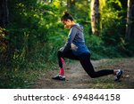 beautiful fitness woman doing... | Shutterstock . vector #694844158