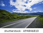 asphalt road in the mountains... | Shutterstock . vector #694846810