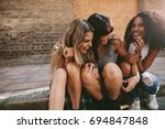 group of young female friends... | Shutterstock . vector #694847848