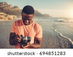 African Man Checking Photos In...