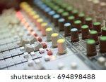 mixer in radio broadcast room   Shutterstock . vector #694898488
