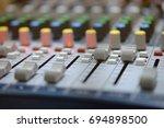 mixer in radio broadcast room | Shutterstock . vector #694898500