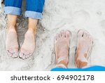 sandy female and male feet on... | Shutterstock . vector #694902178