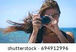A Female Tourist Photographer...