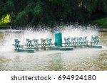 aerator paddle wheels filling... | Shutterstock . vector #694924180