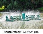 aerator paddle wheels filling... | Shutterstock . vector #694924186