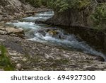 bow river at johnston canyon ... | Shutterstock . vector #694927300
