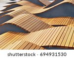 modern curved s shaped brown...   Shutterstock . vector #694931530