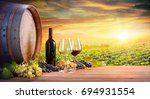 wine glasses and bottle with... | Shutterstock . vector #694931554