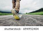 traveler feet on the road close ... | Shutterstock . vector #694952404