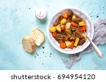 beef stew with vegetables and... | Shutterstock . vector #694954120