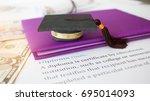 graduation cap on a letter book ... | Shutterstock . vector #695014093