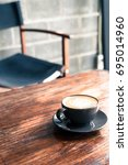 hot latte coffee cup on table | Shutterstock . vector #695014960