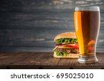 tasty big burger and beer glass ...   Shutterstock . vector #695025010