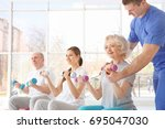 physiotherapist working with... | Shutterstock . vector #695047030