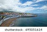Small photo of ANGRA DO HEROISMO, AZORES, PORTUGAL - JUNE 24, 2017: Beach and marina in Angra do Heroismo city, located of Azorean island of Terceira, Portugal.