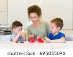 teacher woman play with two... | Shutterstock . vector #695055043