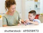 teacher woman playing with... | Shutterstock . vector #695058973