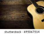 acoustic guitar on wooden... | Shutterstock . vector #695067514