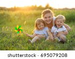 mom with twins of two years old ... | Shutterstock . vector #695079208