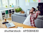 side view of young man leaning... | Shutterstock . vector #695084830