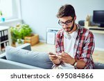 young man leaning on sofa and...   Shutterstock . vector #695084866