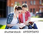 young happy students with books ...   Shutterstock . vector #695095693