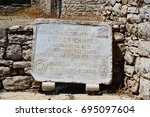 Small photo of BISCEGLIE, ITALY - JULY 29, 2017: Unesco acknowledgment as Heritage witnessed by a culture of peace for humanity of the Dolmen della Chianca in Bisceglie town, Apulia, Italy
