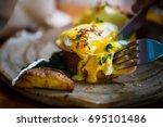 eggs benedict | Shutterstock . vector #695101486