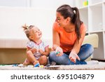 mother and daughter in their... | Shutterstock . vector #695104879