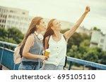 two happy women are having fun... | Shutterstock . vector #695105110