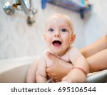 happy laughing baby taking a... | Shutterstock . vector #695106544