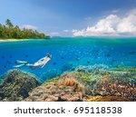 snorkeler swims over a... | Shutterstock . vector #695118538