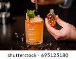 small skull shaped bottle ... | Shutterstock . vector #695125180