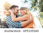 happy couple in love hugging... | Shutterstock . vector #695135260