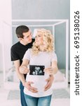 pregnant girl with her husband... | Shutterstock . vector #695138026