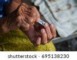 cutting fingernails | Shutterstock . vector #695138230