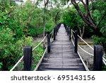 the wooden bridge in the... | Shutterstock . vector #695143156
