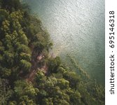 green forest with lake from... | Shutterstock . vector #695146318