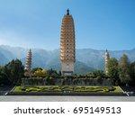 three pagodas at dali  china   Shutterstock . vector #695149513