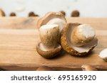 Small photo of Autumn dinner concept - cutting board with copy space - fresh porcini boletus oak mushrooms, high quality,restaurant menu, a la carte