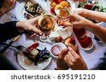 glasses of white wine seen... | Shutterstock . vector #695191210