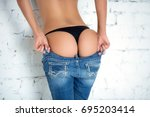 sexy girl takes off her jeans.... | Shutterstock . vector #695203414
