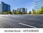 empty road with modern business ... | Shutterstock . vector #695208400
